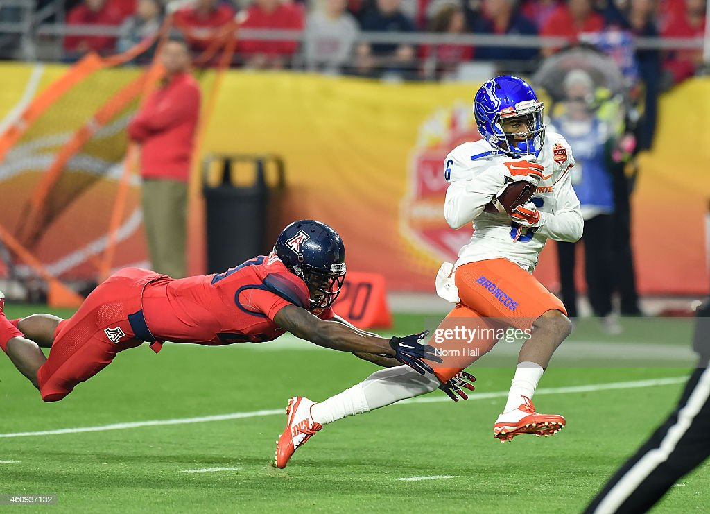 Chaz Anderson #6 of the Boise State Broncos catches a 57 yard touchdown as Jarvis McCall Jr #29 of the Arizona Wildcats attempts to make a diving tackle at University of Phoenix Stadium on December 31, 2014 in Glendale, Arizona.