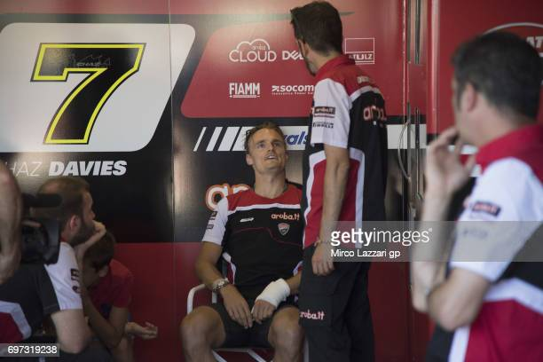 Chaz Davies of Great Britain and ARUBAIT RACINGDUCATI speaks in box before the Superbike Race 2 during the FIM Superbike World Championship Race 2 at...