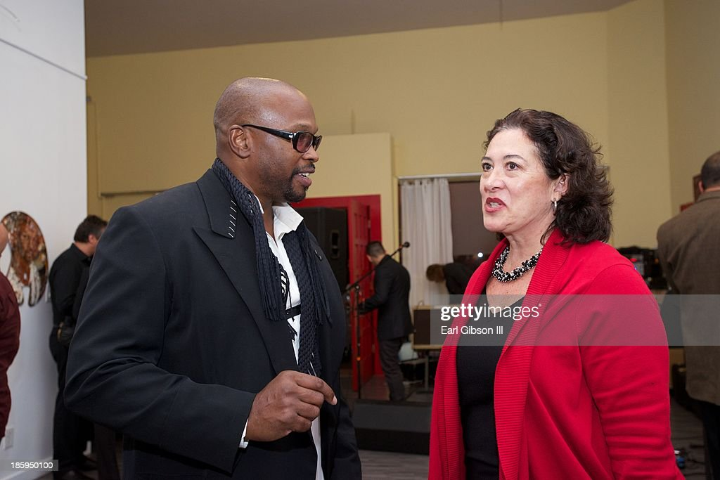 Chaz Guest (artist) and Maria Elena Cabezut discuss art at the 'Visions Of Mexico' An International Retrospective at Quinn Studios on October 25, 2013 in Santa Monica, California.