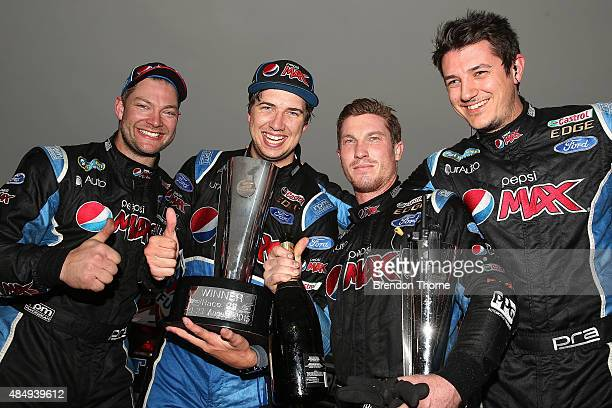 Chaz Mostert driver of the Pepsi Max Crew Ford celebrates victory with his team following race 23 for the V8 Supercars Sydney Motorsport Park...