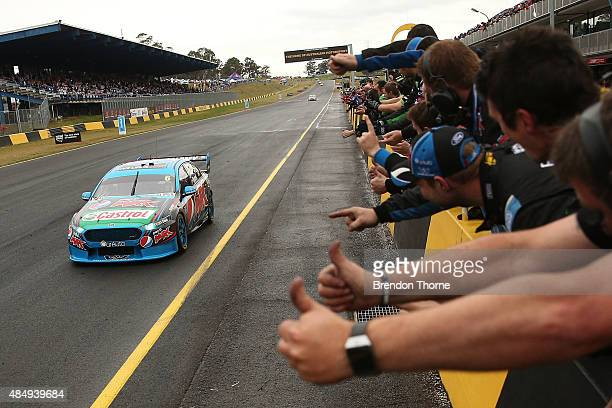 Chaz Mostert driver of the Pepsi Max Crew Ford is cheered by his team after victory in race 23 for the V8 Supercars Sydney Motorsport Park...