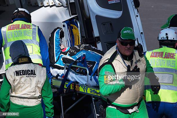 Chaz Mostert driver of the Pepsi Max Crew PRA Ford FG X Falcon is removed from his car by medical staff after crashing out during qualifying which...