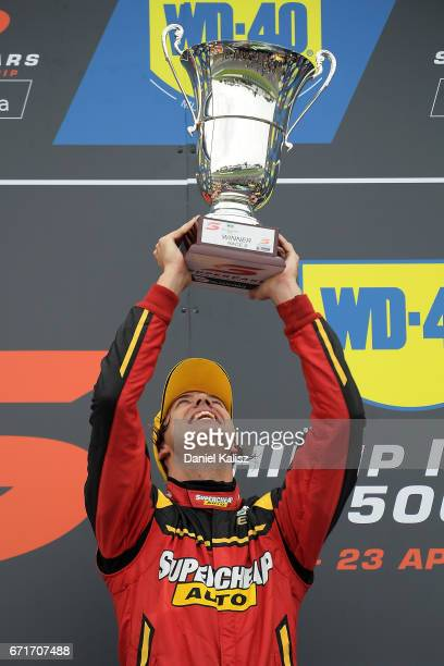 Chaz Mostert driver of the Supercheap Auto Racing Ford Falcon FGX celebrates on the podium after winning race 6 for the Phillip Island 500 which is...