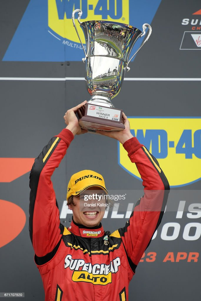 Chaz Mostert driver of the #55 Supercheap Auto Racing Ford Falcon FGX celebrates on the podium after winning race 6 for the Phillip Island 500, which is part of the Supercars Championship at Phillip Island Grand Prix Circuit on April 22, 2017 in Phillip Island, Australia.