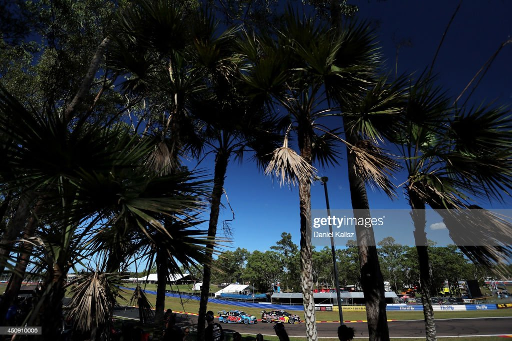 Chaz Mostert (L) drives the #6 Pepsi max Crew Ford and Jamie Whincup drives the #1 Red Bull Racing Australia Holden during practice for the Triple Crown Darwin, which is round six of the V8 Supercar Championship Series at Hidden Valley Raceway on June 20, 2014 in Darwin, Australia.