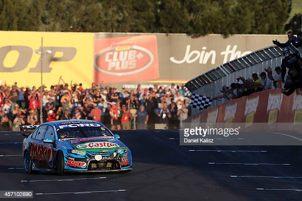 Chaz Mostert drives the Pepsi max Crew Ford celebrates after crossing the line to win the Bathurst 1000 which is round 11 and race 30 of the V8...