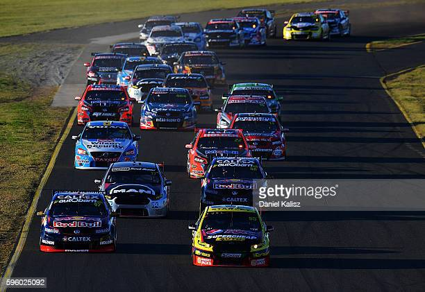 Chaz Mostert drives the Supercheap Auto Racing Ford Falcon FGX leads Shane Van Gisbergen drives the Red Bull Racing Australia Holden Commodore VF at...