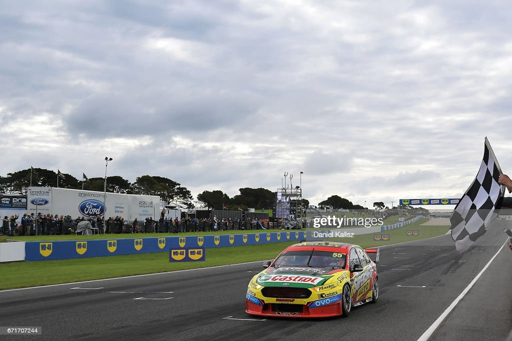 Chaz Mostert drives the #55 Supercheap Auto Racing Ford Falcon FGX crosses takes the chequered flag to win race 6 for the Phillip Island 500, which is part of the Supercars Championship at Phillip Island Grand Prix Circuit on April 22, 2017 in Phillip Island, Australia.