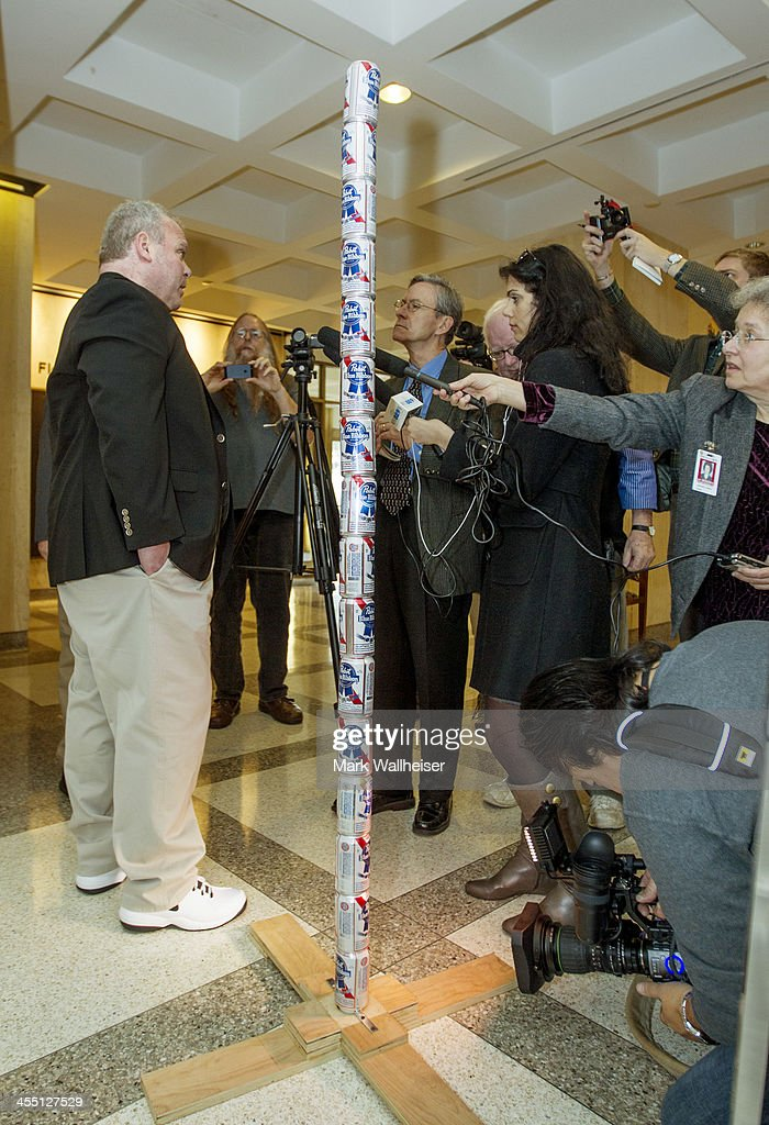 Chaz Stevens from Deerfield Beach Florida talks to the media next to his Festivus pole made out of beer cans in the rotunda of the Florida Capitol...