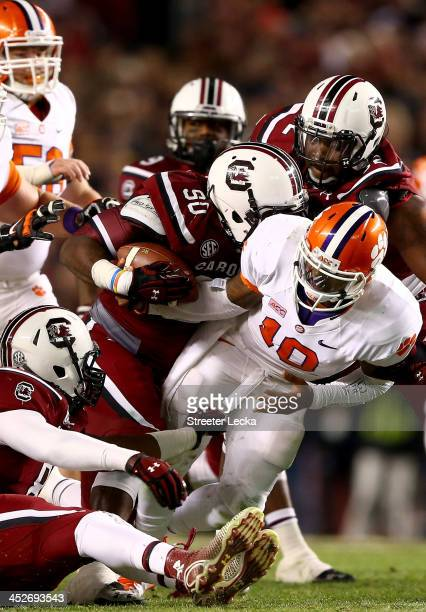 Chaz Sutton of the South Carolina Gamecocks strips the ball from Tajh Boyd of the Clemson Tigers during their game at WilliamsBrice Stadium on...