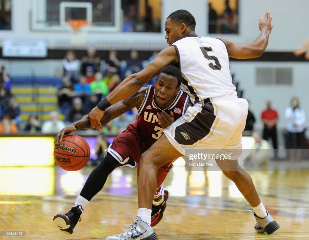 Chaz Williams of the Massachusetts Minutemen gets tangled up with Jordan Gathers of the St Bonaventure Bonnies while driving to the basket during the...