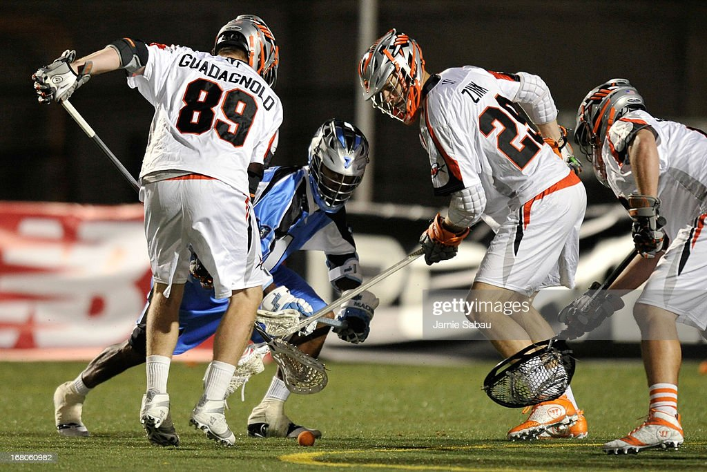 Chazz Woodson #1 of the Ohio Machine attempts to gain control of a loose ball from Tom Guadagnolo #89 of the Denver Outlaws and Lee Zink #29 of the Denver Outlaws in the second half on May 4, 2013 at Selby Stadium in Delaware, Ohio. Denver defeated Ohio 13-8.