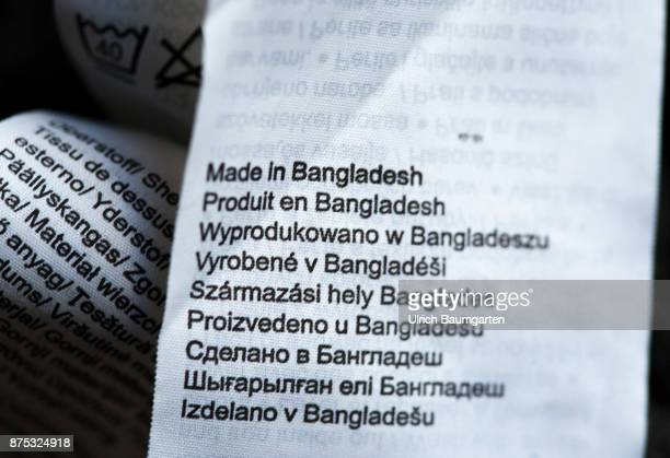 Cheap clothes made in the Third World under inhumane conditions The photo shows patches Made in Bangladesh in a garment