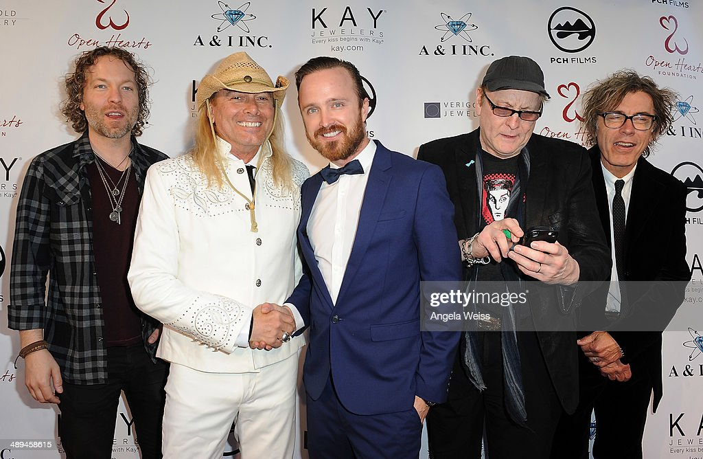 Cheap Trick and actor Aaron Paul attend at the 'Open Hearts Foundation Gala' on May 10, 2014 in Malibu, California.