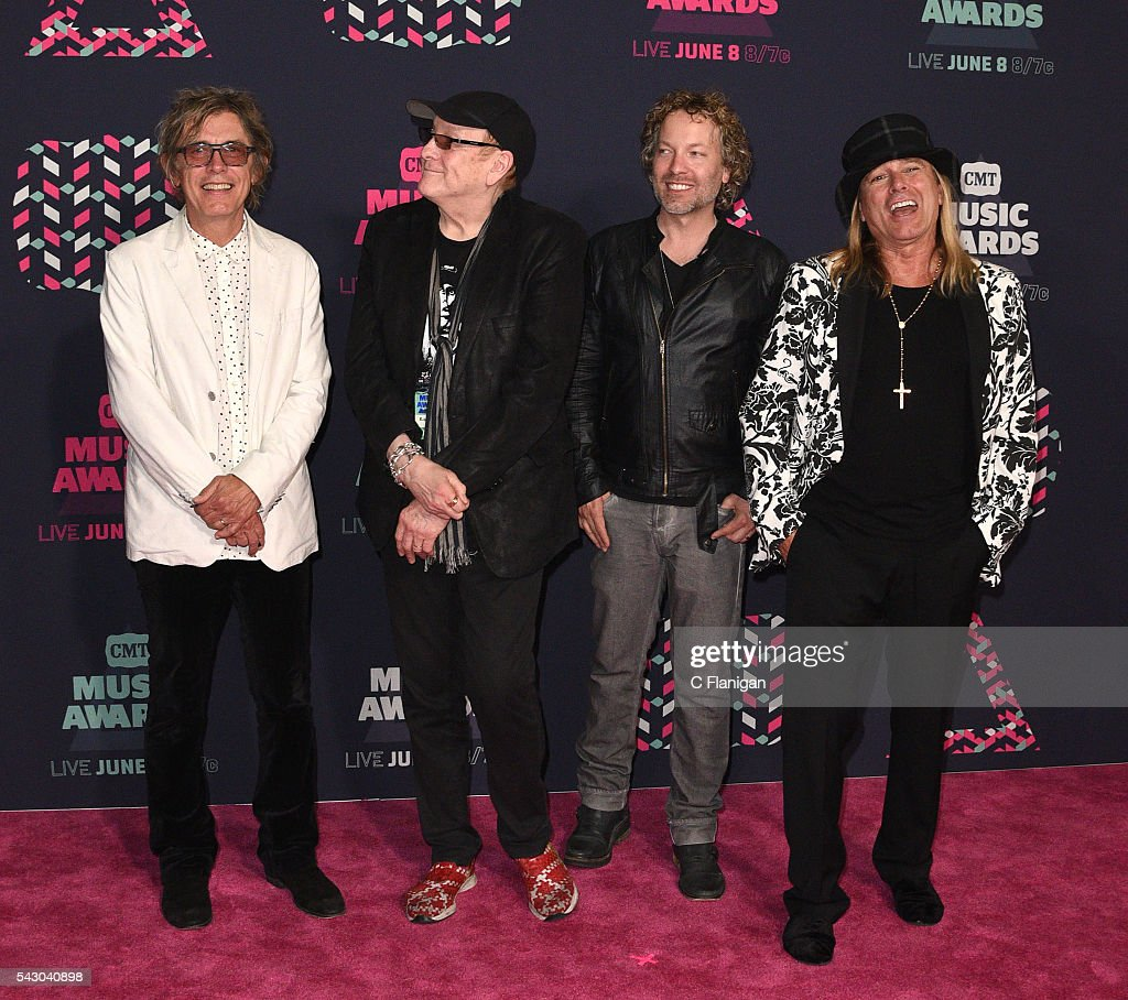 Cheap Trick's Tom Petersson Rick Nielsen Daxx Nielsen and Robin Zander attend the 2016 CMT Music awards at the Bridgestone Arena on June 8 2016 in...