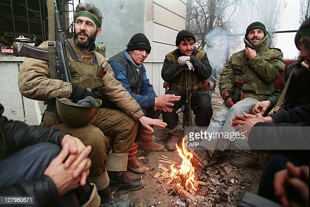 Chechen fighters rest beside a fire during a break in the fighting on January 09 1995 in central Grozny The Russian government's press service said...