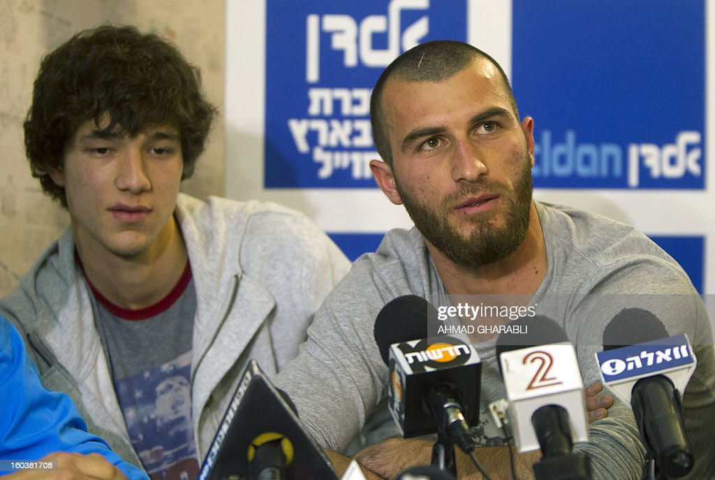 Chechen football players Dzhabrail Kadaev (L) and Zaur Sadaev , signed from Russian League club Terek Grozny, are introduced by the Beitar Jerusalem football club to the press in Jerusalem on January 30, 2013. Beitar Jerusalem, owned by Russian-Israeli Arkady Gaydamak, is in turmoil after some fans lashed out at the owner's plan to sign the two Muslim players, insisting the club would remain 'pure' and causing uproar during a weekend game.