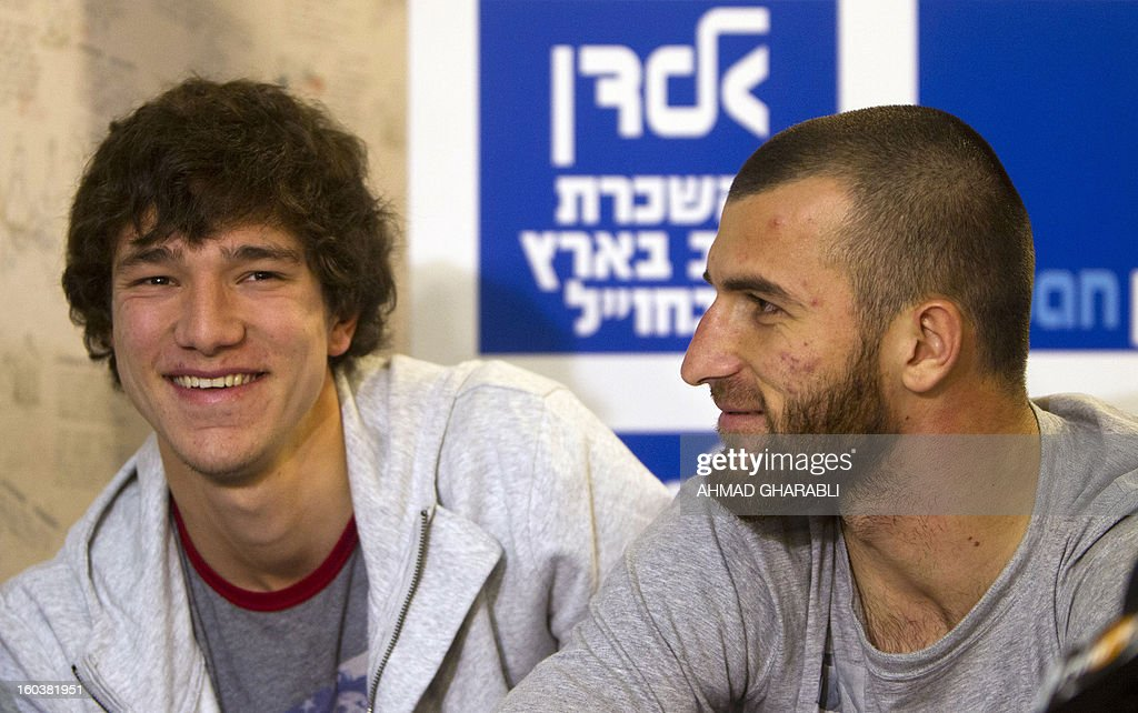 Chechen football players Dzhabrail Kadaev (L) and Zaur Sadaev, signed from Russian League club Terek Grozny, are introduced by the Beitar Jerusalem football club to the press in Jerusalem on January 30, 2013. Beitar Jerusalem, owned by Russian-Israeli Arkady Gaydamak, is in turmoil after some fans lashed out at the owner's plan to sign the two Muslim players, insisting the club would remain 'pure' and causing uproar during a weekend game.