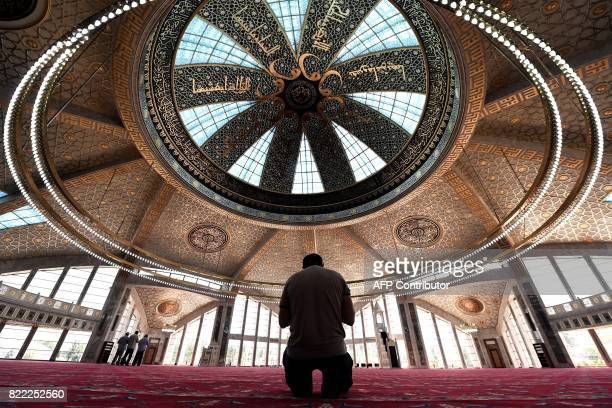 Chechen Muslim prays in the Aymani Kadyrova Mosque built in hitech style in the city of Argun second largest city of Chechnya about 18 km from Grozny...