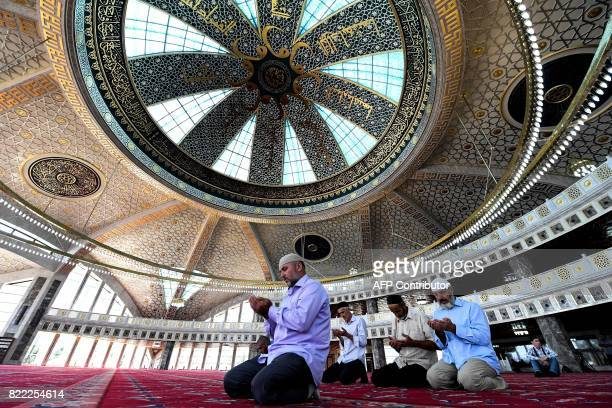 Chechen Muslims pray in the Aymani Kadyrova Mosque built in hitech style in the city of Argun second largest city of Chechnya about 18 km from Grozny...