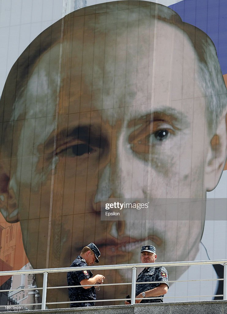 Chechen police in front of a portrait of Russian President Vladimir Putin before the Russian Cup Final match between FC Anji Makhachkala and PFC CSKA...