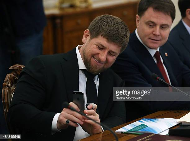 Chechen President Ramzan Kadyrov holds an Apple iphone during a meeting of State Council Presidium at the Novo Ogaryovo State Residence on February24...