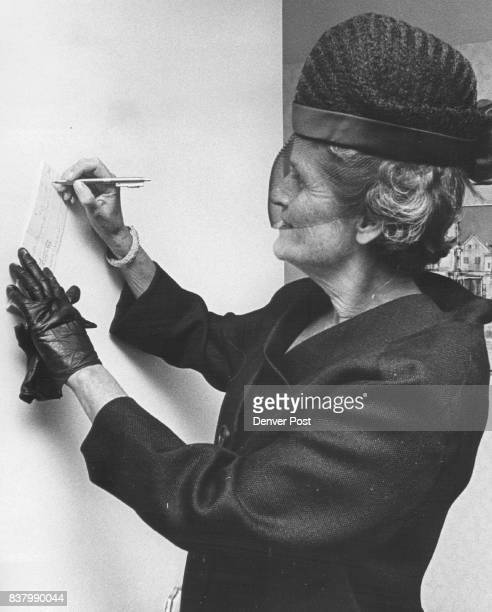 Check for New Chapeau Like many another teagoer Mrs Edwin Francis writes a check for the chapeau she wore home from the recent Spring Bonnet Tea The...