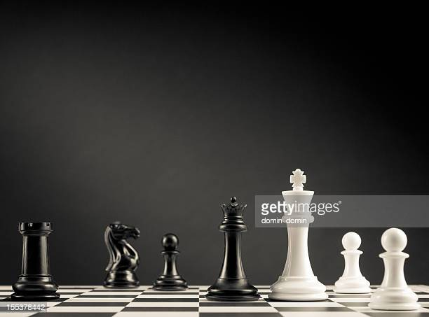 Check move, black and white chess pieces on chess board