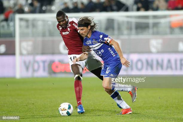 Check tidiane Diabate of Metz and Yannick Cahuzac of Bastia during the Ligue 1 match between Fc Metz and SC Bastia at Stade SaintSymphorien on March...