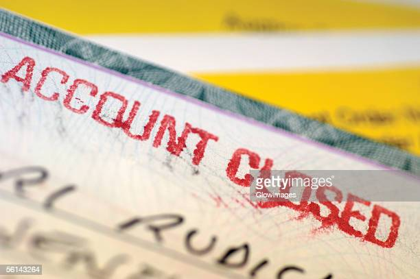 'Check with account closed written on it, close-up'