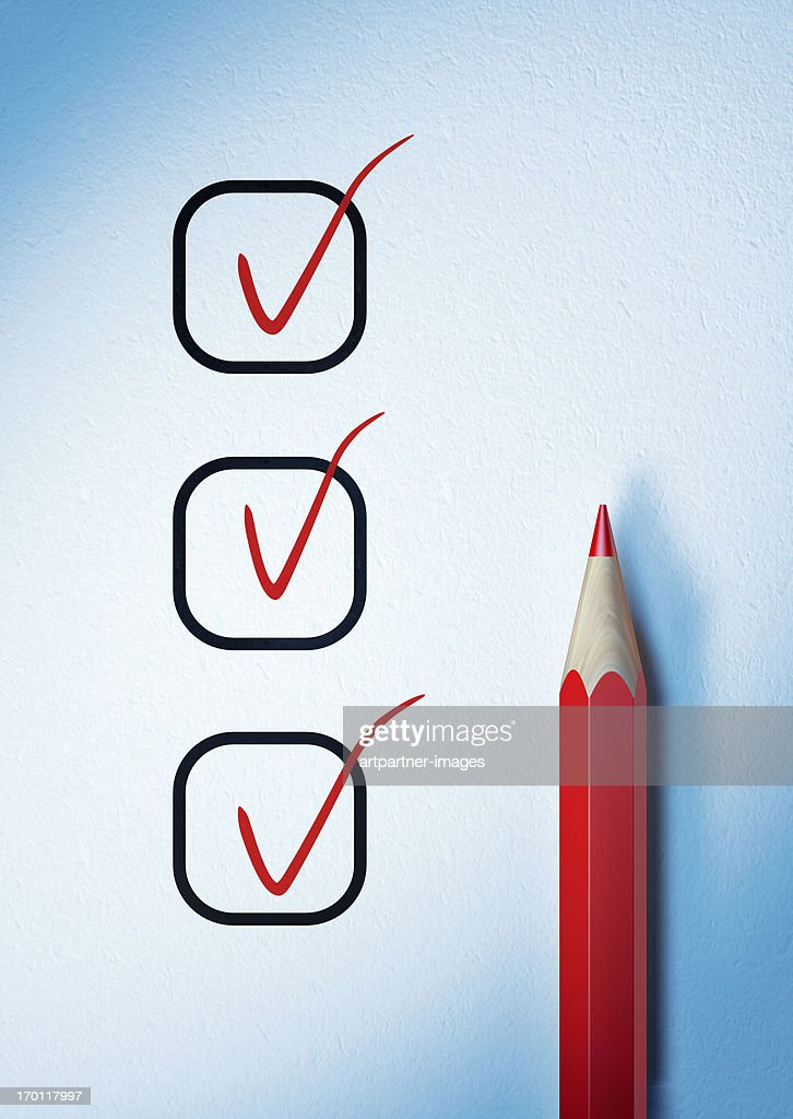 Checked off or ticked list and a red pencil : Stock Photo