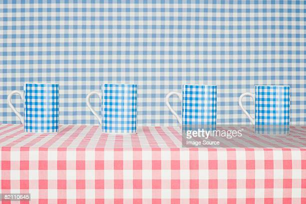 Checker pattern mugs and cloth
