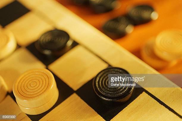 Checker pieces on edge of board
