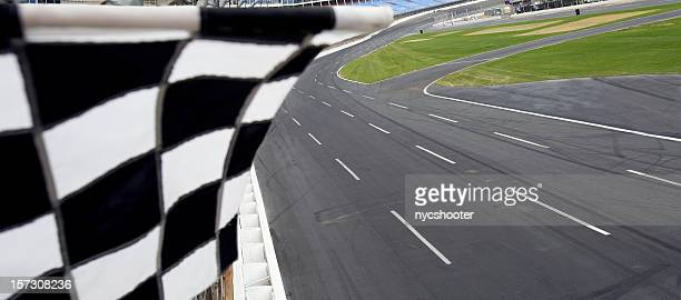 Checkered flag and motor speedway