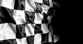 Checkered racing flag on black