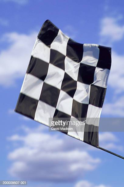 Checkered flag signalling finish