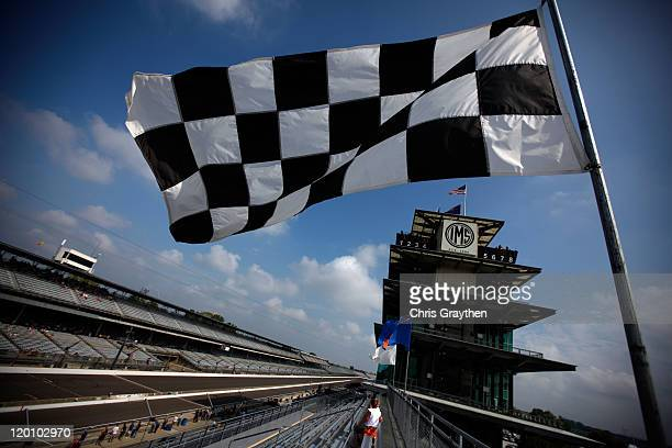 A checkered flag waves in the wind from the stands in the infield during practice for the NASCAR Sprint Cup Series Brickyard 400 at Indianapolis...