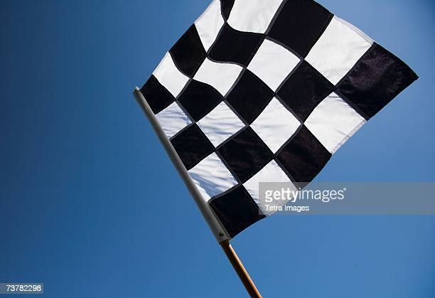 Checkered flag with blue sky