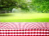 Checkered red picnic tablecloth empty space table.Product display background.