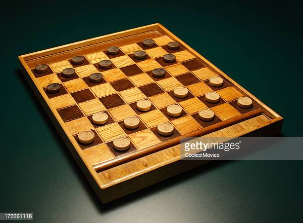 Checkers! Make your move! Checkerboard on Green Table