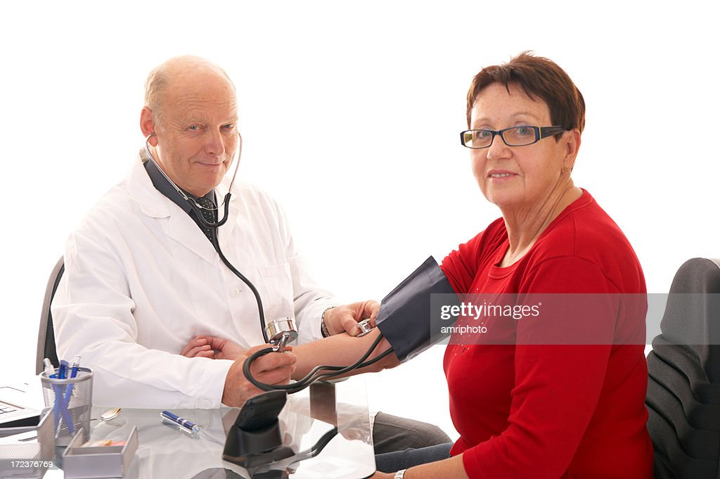 checking blood pressure wide : Stock Photo