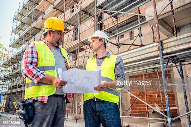 Checking blueprints on a construction site
