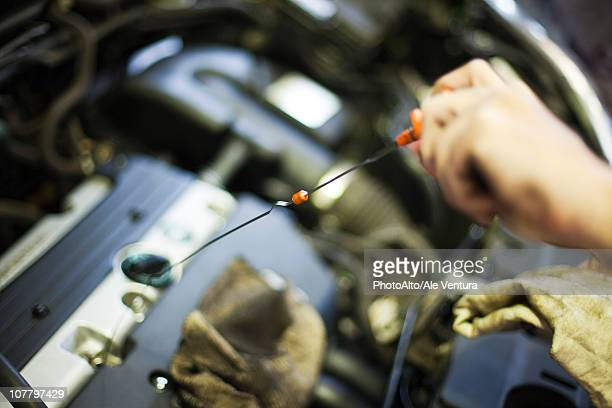 Checking car engine oil