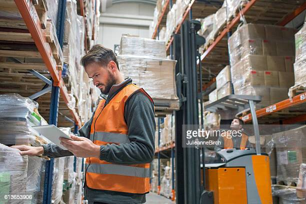 Checking delivery palet in warehouse