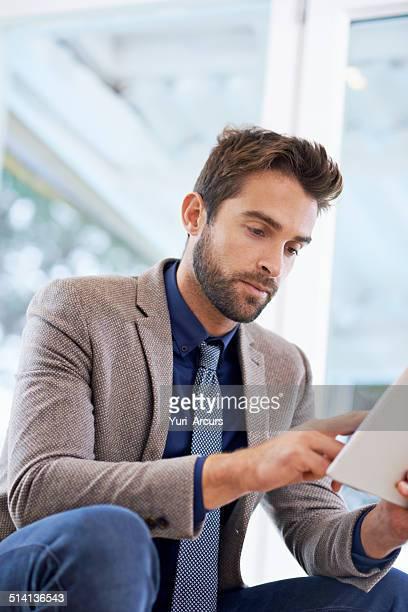 Checking his digital diary
