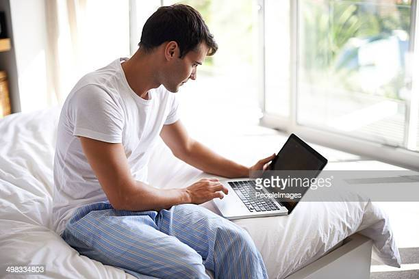 Checking his emails in the morning