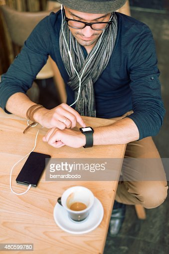 Checking his smartwatch : Stock Photo