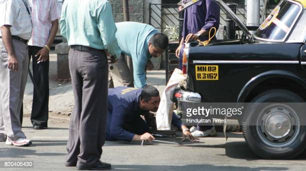 BDS checking Lalan Pandey's Taxi who received a call of Bomb at CST Rly station in Mumbai on Wednesday