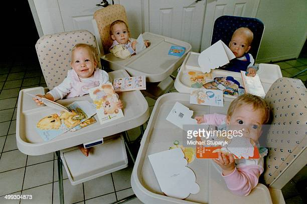 Checking over their first birthday cards yesterday are the Stirk quadruplets from left Margaret Jennifer Iain and Anne Averaging just 27 pounds each...