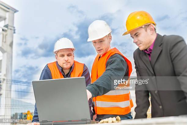Checking plans on laptop